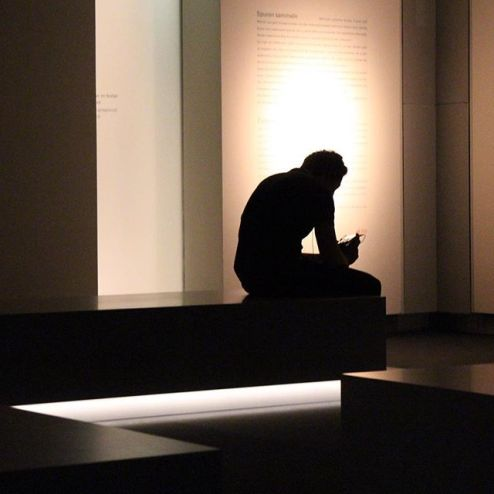 silhouette of a man, thoughtful guy in museum, holocaust museum visitor, shadow portraiture, portrait photographer, people in german, photos of berlin germany, photography in berlin, images of berliners