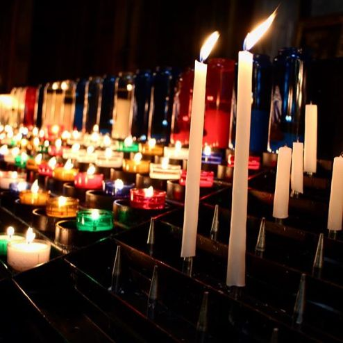 Glowing candles in St Eustache church, Paris France religious site