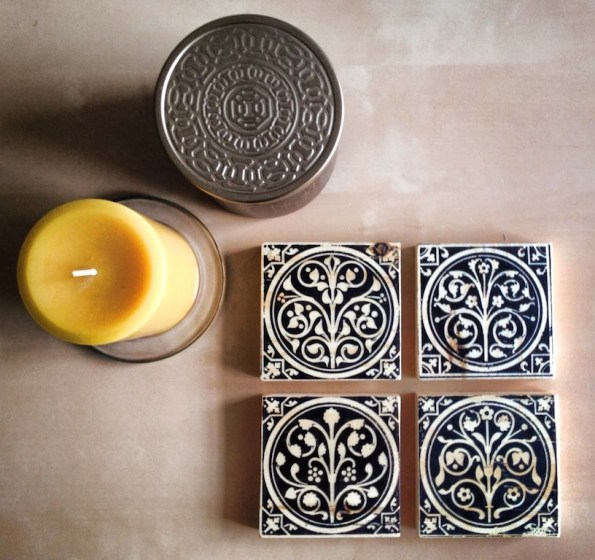 beautiful styling of four wood art blocks with a hammered tin candle
