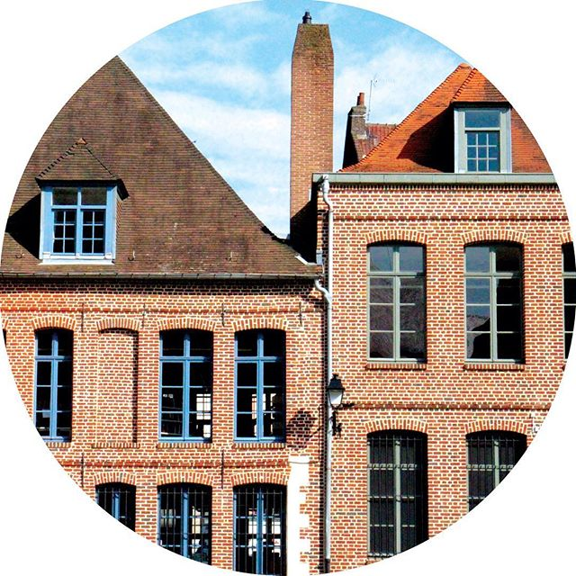 Red brick buildings against a blue sky in Lille, France