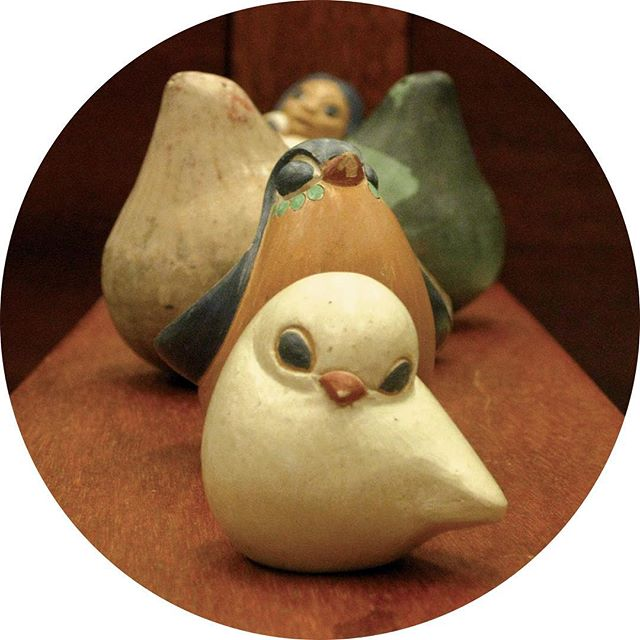 Ceramic birds from South America in a line