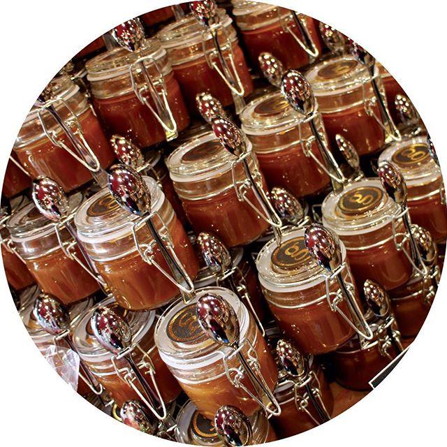 Pots of chocolate caramel sauce in a Paris chocolatier's shop