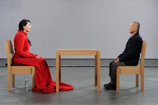 side angle w: table and man