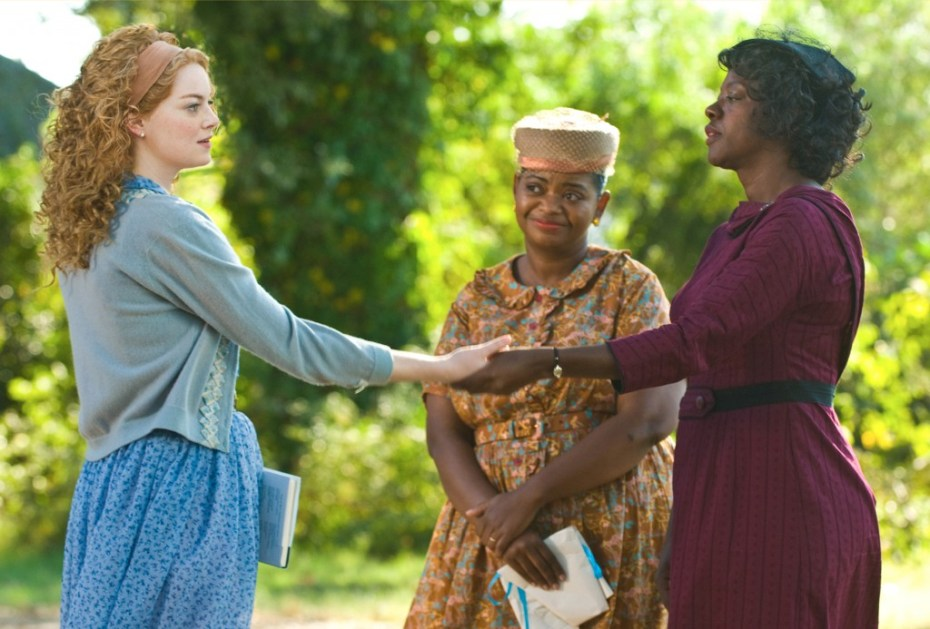 """""""THE HELP"""" 946_D_08558R In Jackson, Mississippi in 1963, (left to right) Skeeter Phelan (Emma Stone), Minnie Jackson (Octavia Spencer) and Aibileen Clark (Viola Davis) together take a risk that could have profound consequences for them all in DreamWorks Pictures' drama, """"The Help"""", based on the New York Times best-selling novel by Kathryn Stockett. Ph: Dale Robinette ©DreamWorks II Distribution Co., LLC. All Rights Reserved."""