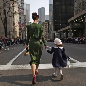 A mother and daughter walk down the Fifth Avenue in Manhattan at the Easter Bonnet Parade in New York April 4, 2010.