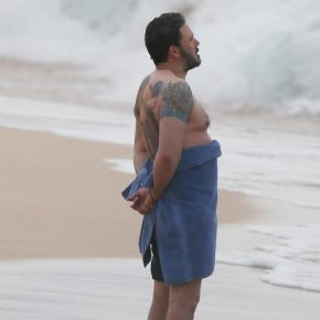 We Are All Sad Ben Affleck on a Beach with a Back Tattoo