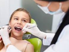 girl in dental care