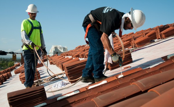 installers working with clay roof tile and Polyset AH-160 application on Orchard Hills K-8 School, Irvine, CA