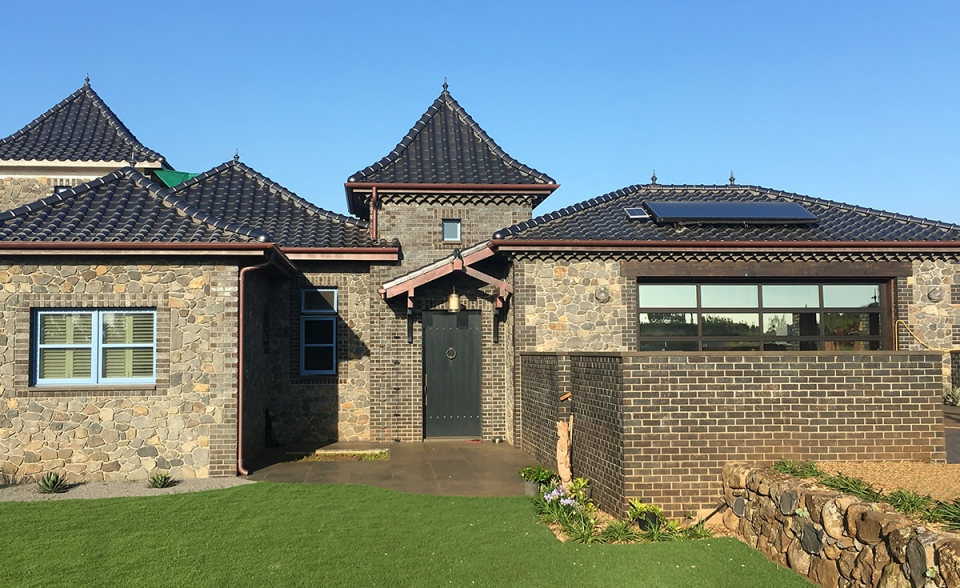 Stone home with Improved S C23 Metallic Silver Clay Roof Tile in Maui, HI