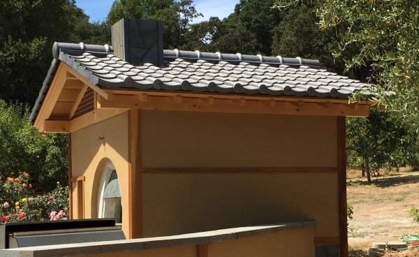 Detail of Oriental-Japanes clay roof tile in C09 Japanese Black on a backyard pizza oven in Northern California