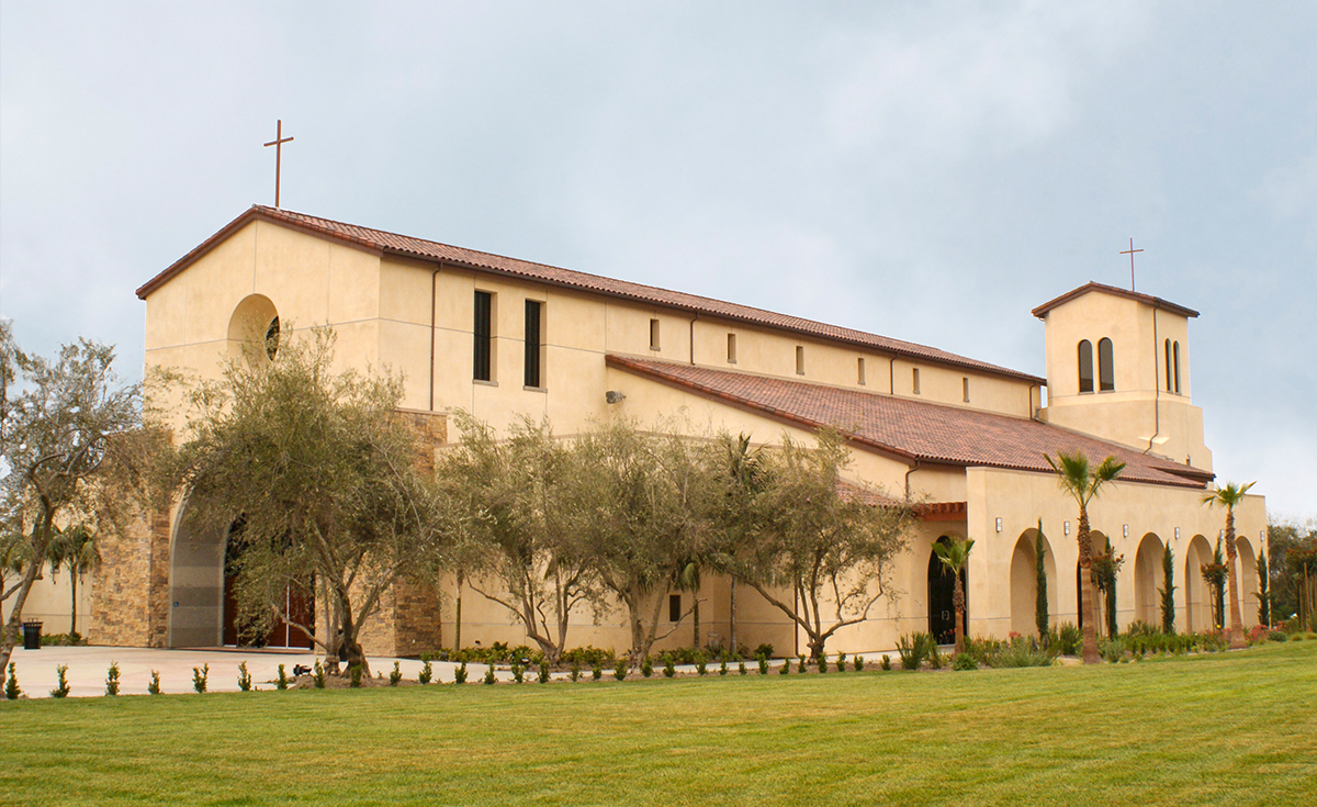 One Piece S Mission clay roof tile in B330-R Old Santa Barbara Blend with two piece eace line on Holy Trinity Catholic Church in Ladera Ranch, California