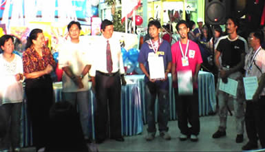 Emil Zion V. Punzalan (third from right) also in Fuschia T-shirt receives the 3rd Gold Medal of Excellence together with other participants in the Photography (Event Coverage) event.