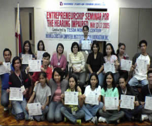 Students pose together with the TESDA Seminar organizers and speaker Ms. Joy Urmeneta seated in the middle.