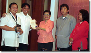 Sir Jojo and Sir Ervin receiving the plaque of recognition from Dir. Fermin.