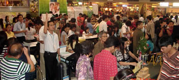 Participants visit various booths during the event.