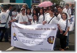 MCCID Students Parades with Banner