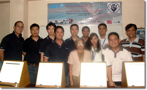 Manila Jaycees members (from left) VP for External Affairs Glenn Chan, Director for Membership Development Charlie Gaw, Project Vice Chairman Paul Sy, JCI Manila President Mark Steven Ong, Project Chairman Andrei Dy and Project Vice Chairman Jay Ramos Jr. pose together with MCCID College Officials and students led by School Registrar Mrs. Remedios Esposa, Madonna Hermosura representing DACDT Class, MCCID Student Organization President Jerome Marzan, MCCID Deaf Coordinator Sir Ervin Reyes and MCCID Training Director Sir Jojo Esposa.