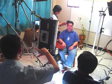 MCCID Alumnus Gimar Aguillon prepares for interview. Gimar currently works as a web designer at Nova Management, Inc.