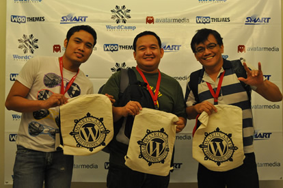 MCCID web designers show off their WordCamp kits.