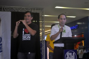 Sir Jojo interprets for Tarlac City Mayor's Representative.