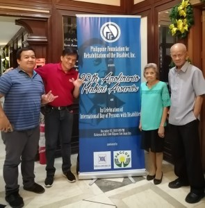 MCCID Family pose beside the official tarpaulin