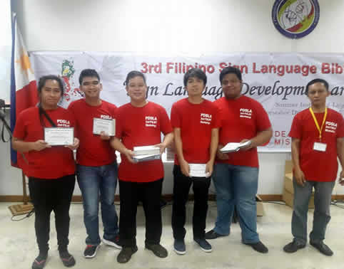 Dheen Jan and Hans (left) receives their certificates given by Ptr Mamerto Cortez Jr., former faculty of MCCID Tiaong, Quezon Branch