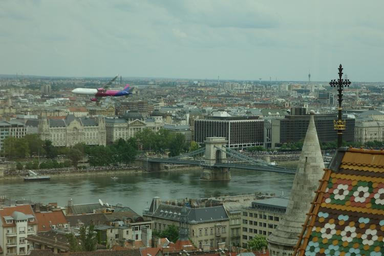 rare sight of airplane flying along Danube River in Budapest