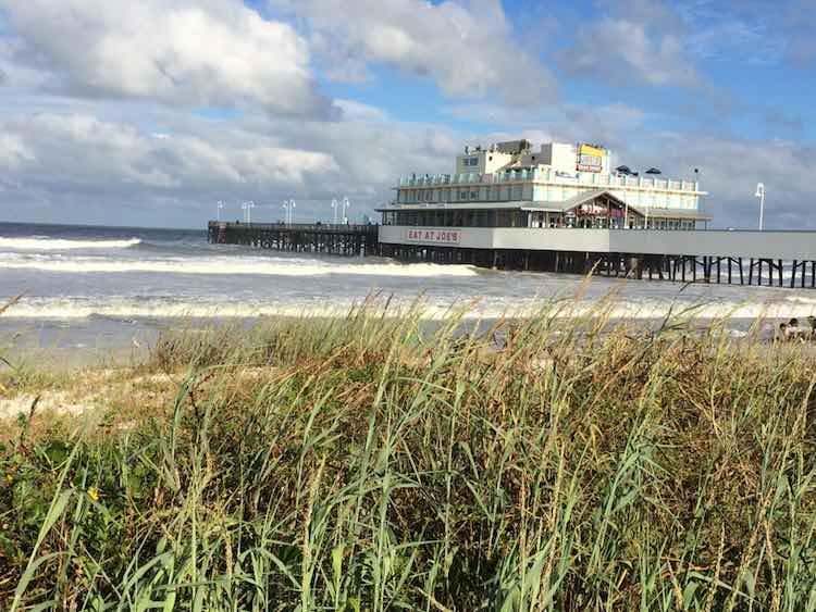 view of Daytona Beach pier from sandy dune