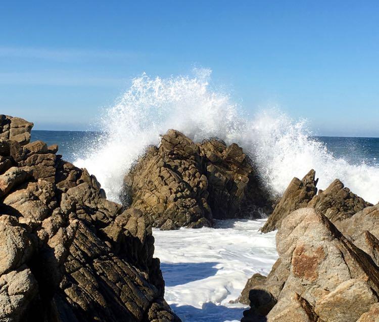 water splashing rocks in Monterey California