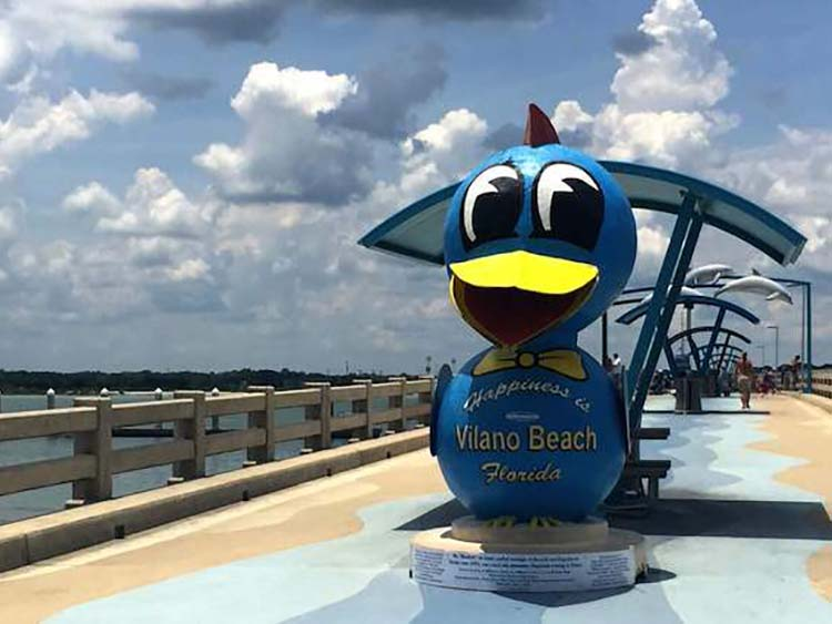 colorful and happy blue bird statue at Vilano Beach pier