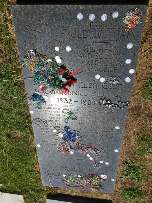 Old Joe Cain tombstone with Mardi Gras beads