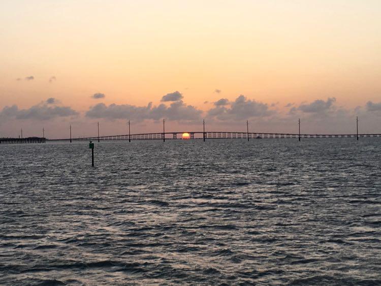 Texas Gulf Coast sunset under bridge