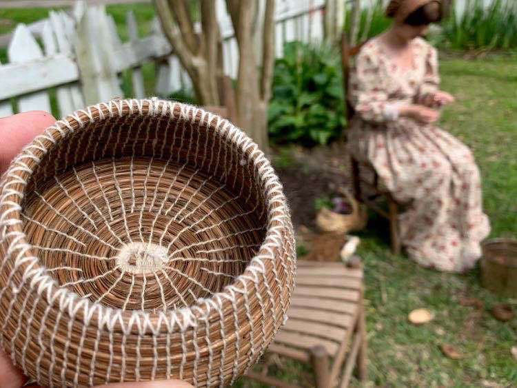 Creole reenactor making straw basket at Vermilionville