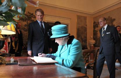Her Majesty the Queen signing the visitors book at Hillsborough Castle