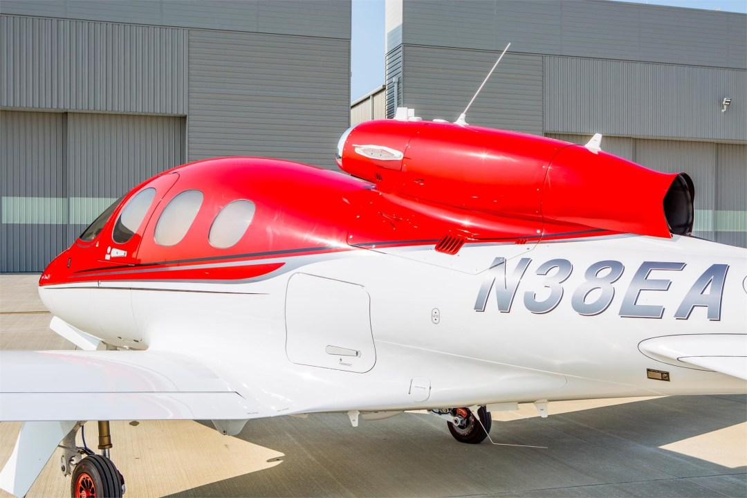 Cirrus Vision Jet SF50 in front of Conroe Airport Hangar