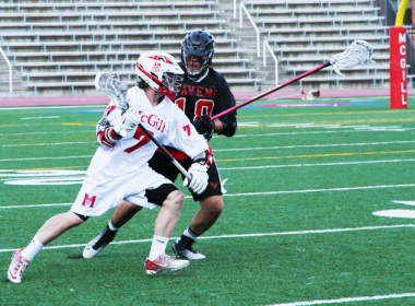 Jake Gutman of McGill Redmen lacrosse makes a play