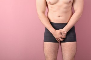 man covering up from erectile dysfunction