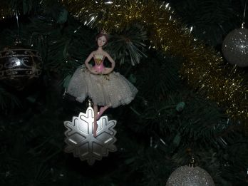 Depiction of the 9th day of Christmas with a lady dancing ornament