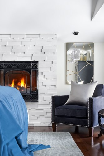 The luxury of this cozy reading zone by the raised Quartzite Fireplace