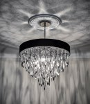 Contemporary Chandelier of Chrome Orb cuts and Black Drum