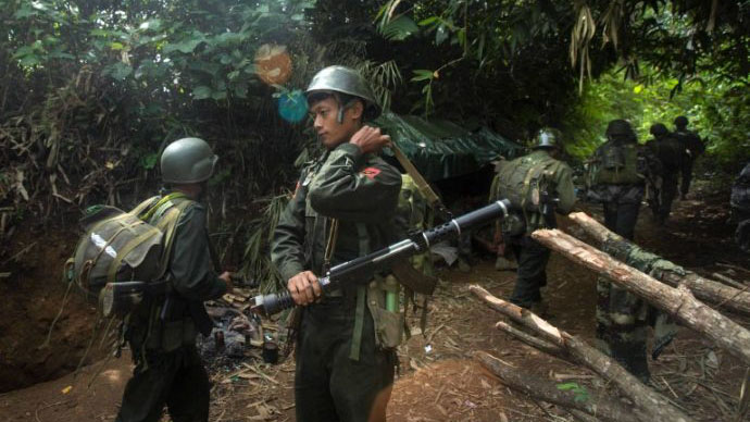 (FILES) In this file photograph taken October 14, 2016, armed rebels belonging to the Kachin Independence Army (KIA) ethnic group move towards the frontline near Laiza in Kachin state. At least 11 people have died this month December 2016 in northern Myanmar in escalating clashes between security forces and armed insurgents that have undercut Aung San Suu Kyi's bid for peace. Thousands have fled their homes in northern Shan state since the fighting erupted in late November, with many crossing the border into China. / AFP PHOTO / HKUN LAT