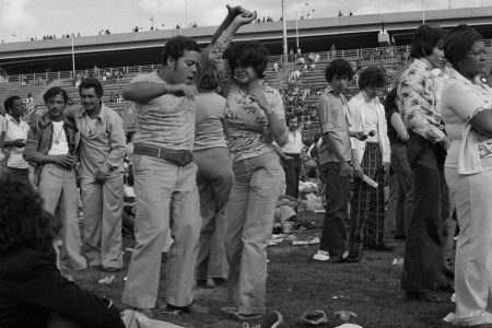 Summer 2018 P Credit Course  Rhythm   Power  Dance  Immigration  and     A casually dressed couple dances salsa with people in the background on  Randall s Island in 1974