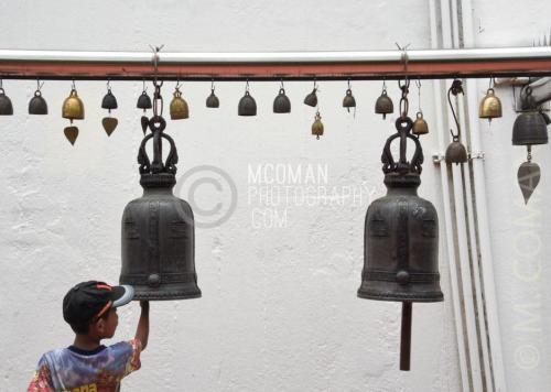 Boy Ringing Bell at Golden Mount Wat Saket in Bangkok