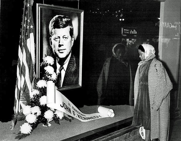 Mrs. Daisy Fisher, of Detroit, pause, reflects on the JFK memorial displayed at the J. L. Hudson department store, downtown Detroit, Friday evening, November 22, 1963.