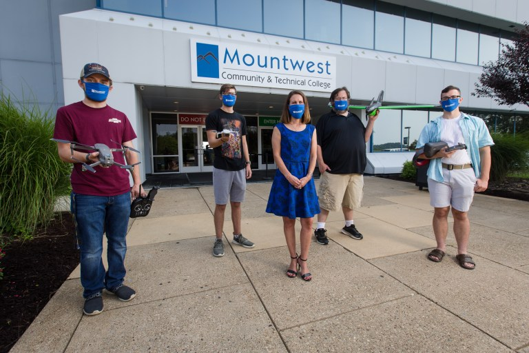 Instructor Megan Click, center, with students in Mountwest's Geospatial Science & Technology Program on Wednesday, Aug. 26, 2020, outside of Mountwest Community & Technical College in Huntington. The program has been named part of the Federal Aviation Administration's a Unmanned Aircraft Systems-Collegiate Training Program Initiative.