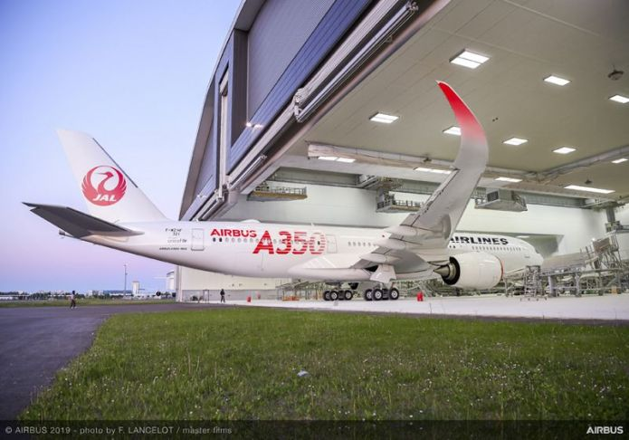 A350 900 Japan Airlines rolls out paint shop 005