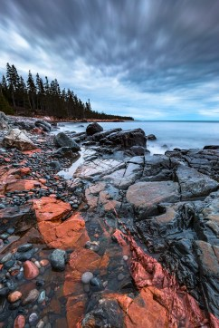 An igneous intrusion on the rocky, cobbled shore of Acadia National Park, Mount Desert Island, Maine.