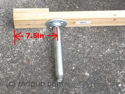 Attaching a floor flange and 10 inch nipple to the bottom of the head