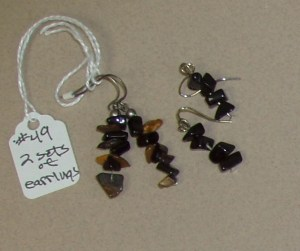 49. Two Sets of Earrings (one tiger, one black)