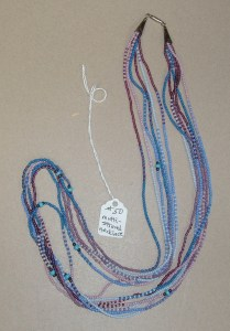50.  Multi-Strand (six strands) Necklace in Blues and Pinks